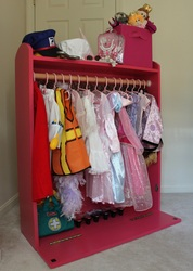 dress-up storage (hinged front for theater access)